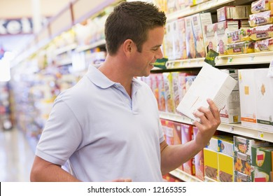 Young man grocery shopping in supermarket