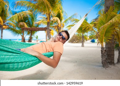Young man in hammock on the exotic tropical resort