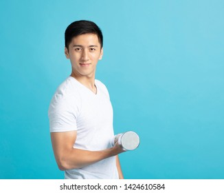 young man Hand holding dumb-bell
