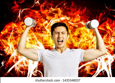 young man Hand holding dumb-bell with burning fire background