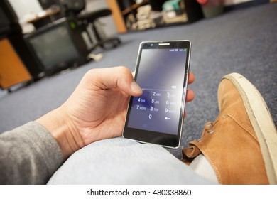 Young man hand holding secured mobile phone