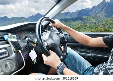 Young man hand holding to steering wheel
