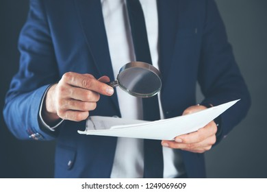 young man hand magnifier and paper