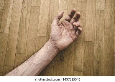 young man hand on wooden floor from above shot