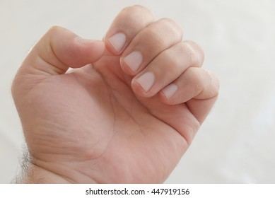 Young man hand over white background. Grabbing something