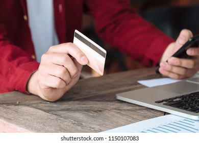 Young man hands using smartphone to shopping online at the city. Easy E-commerce Website Shop by Smartphone and Laptop. Business and modern lifestyle concept