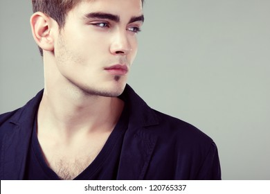 Young man handsome face closeup, sexy guy looking at camera, isolated