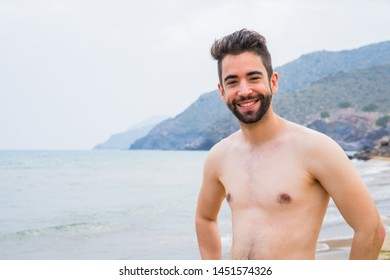 Young man happy on the beach