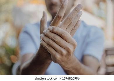 ํํClose up Young man has hand pain , health care concept