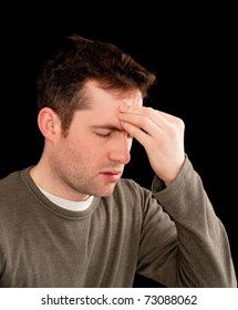 A young man has a headache or is stressed or has found out bad news