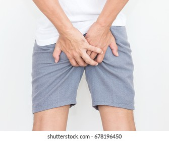 Young man has pain in the butt, Hemorrhoids, Anal disorders.
