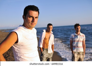 young man have good time and relax at beautifu beach at seaside