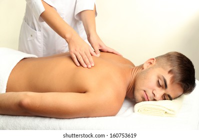 Young man having back massage close up
