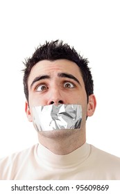 Young man having gray duct tape on his mouth.Help expression on his face.White background and copy space.