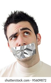 Young man having gray duct tape on his mouth.Wondering expression on his face.White background and copy space.