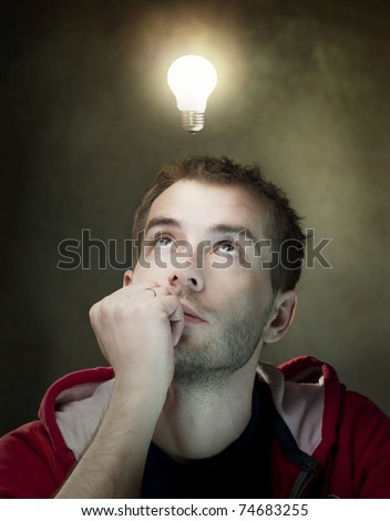 Young Man Having an Idea. Light bulb above his head