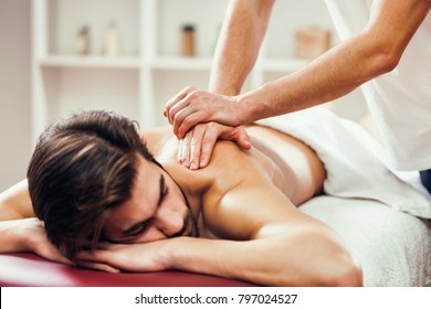 Young man is having massage on spa treatment.
