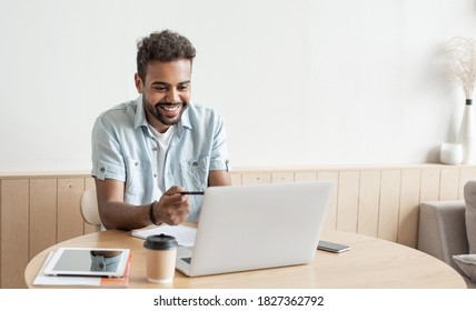 Young man having meeting online. Student men using laptop computer at home. Working, studying, online video conferencing, distance education, communication online, social distancing concept