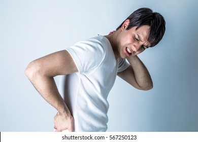 young man having a pain in his neck and low back