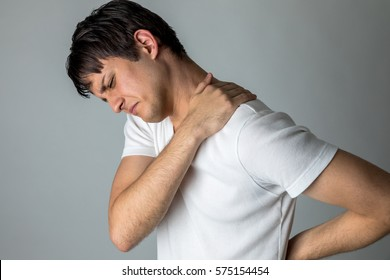 young man having a pain in his neck