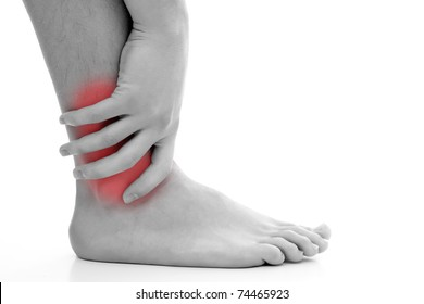 Young man having pain in his ankle