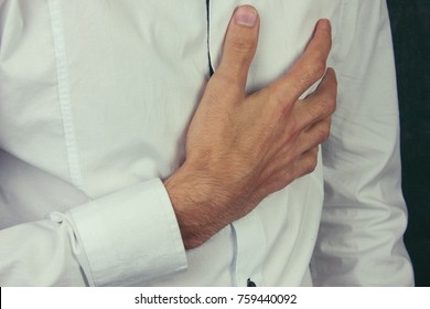 young man having a pain in his breast