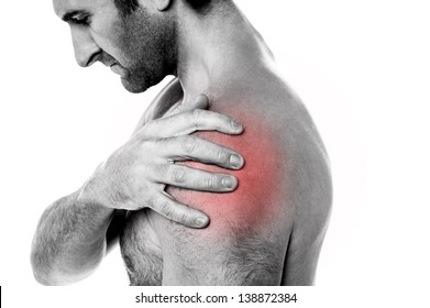 Young man having shoulder joint pain, closeup shot.