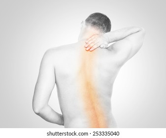 Young man having spine pain