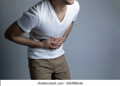 young man having a stomachache