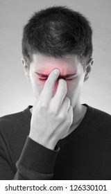 Young man having trouble with sinus pain