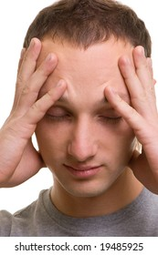young man with headache over white background