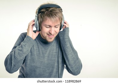 Young man with headphones against white background