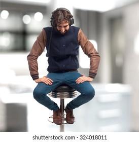young man with headphones bar stool