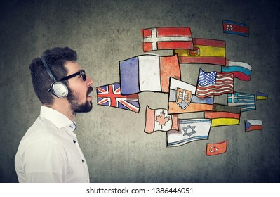 Young man in headphones learning different languages