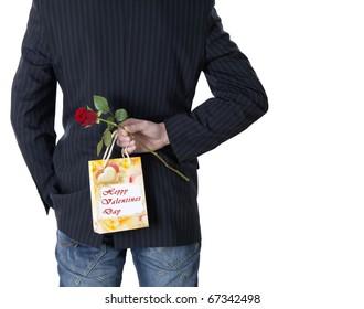 Young Man hiding a sirprise gift
