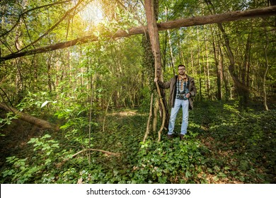 Young man is hiking in the beautiful woods