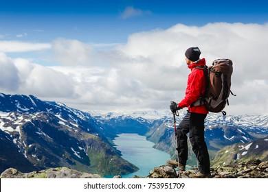 Young man Hiking in in the mountains. Besseggen Ridge. Yotunheimen national park. Norway