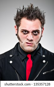 A young man in his 20's dressed up as an emo goth character.