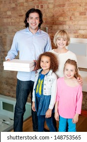 Young man with his family holding pizza boxes