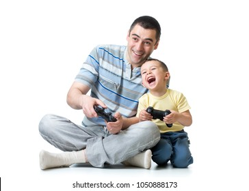 Young man and his kid son playing videogame at home