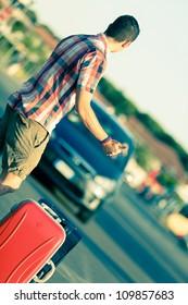 Young Man Hitchhiking