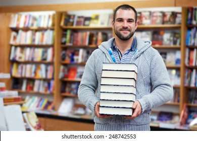 Young man hold books in the library
