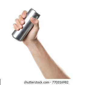 Young man holding aluminum can against white background