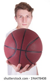 Young man holding a basketball in his hands