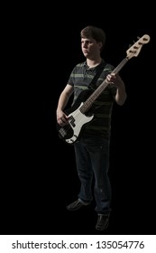 Young man holding a bass guitar musical instrument