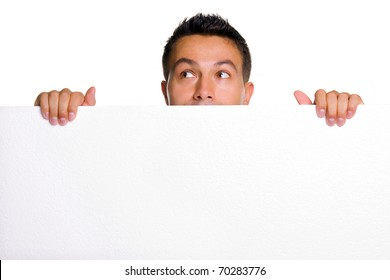 Young man holding a blank white board