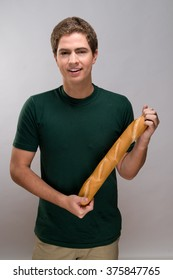 Young man holding bread
