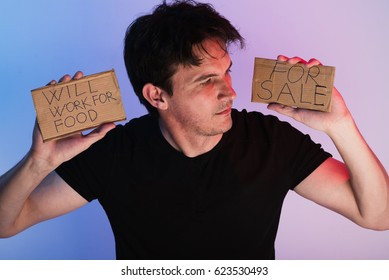 young man holding the cardboard sings