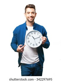 young man holding a clock