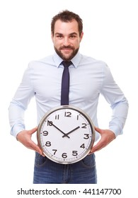 Young man holding a clock isolated on white